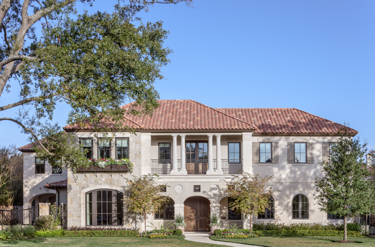 Residential front exterior architectural photograph of a tanglewood residence with tile roof and stucko finish