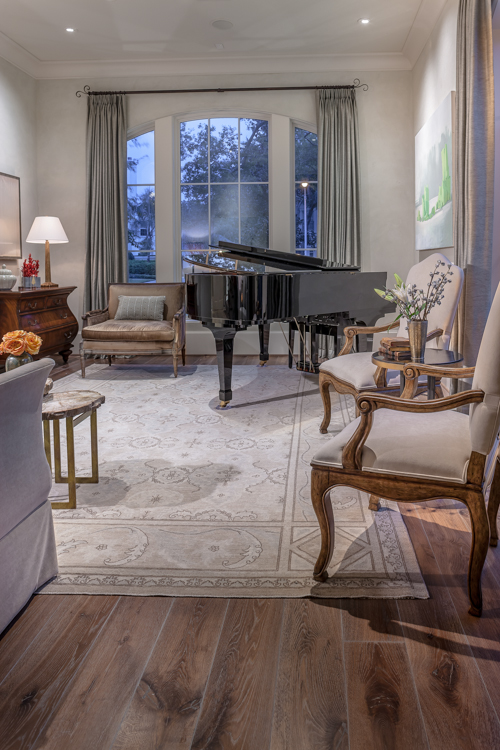 Residential architectural photograph of a tanglewood residence music room looking through window into front yard.