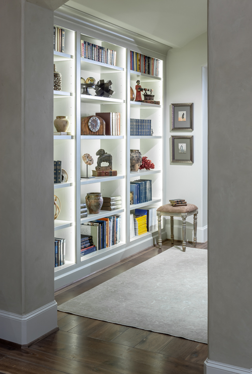 Residential architectural photograph of a tanglewood residence upstaires reading niche with built in book case detail.